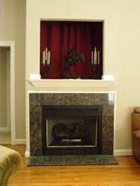 Marble surround fireplace with gas logs
